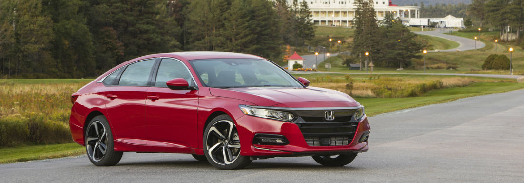 2018 Honda Accord Sport 20t In Bright Red Shown Parked Front Of Large Ski