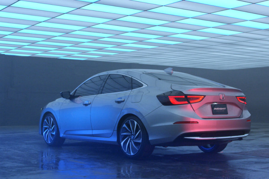 rear three quarter view of 2019 honda insight prototype in underground fluorescent lit garage