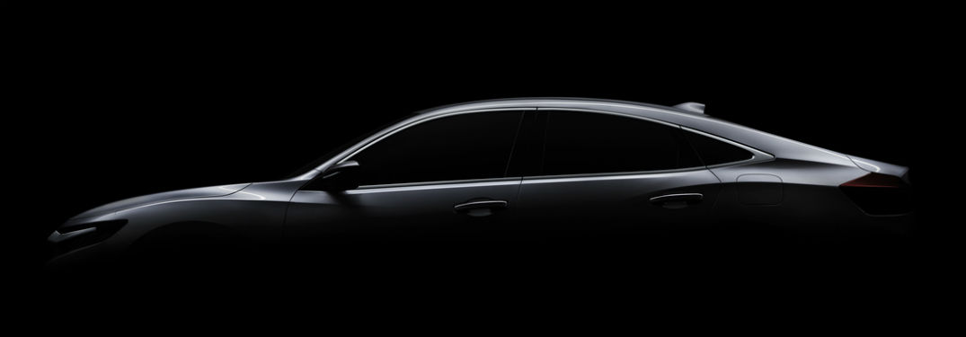 teaser silhouette of honda insight prototype on black background