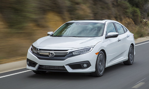 2018 Honda Civic white sedan driving through the country