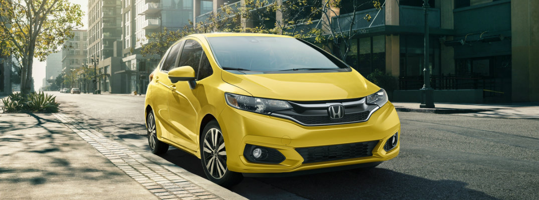 2018 Honda Fit city street with trees