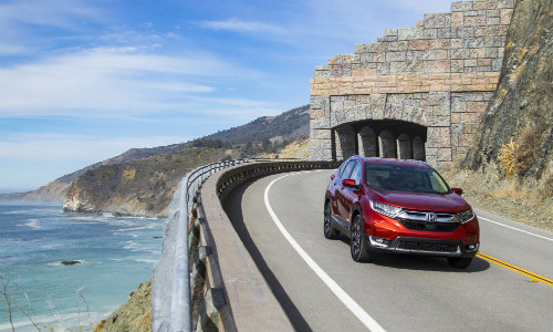 2018 Honda CR-V driving out of tunnel near the water