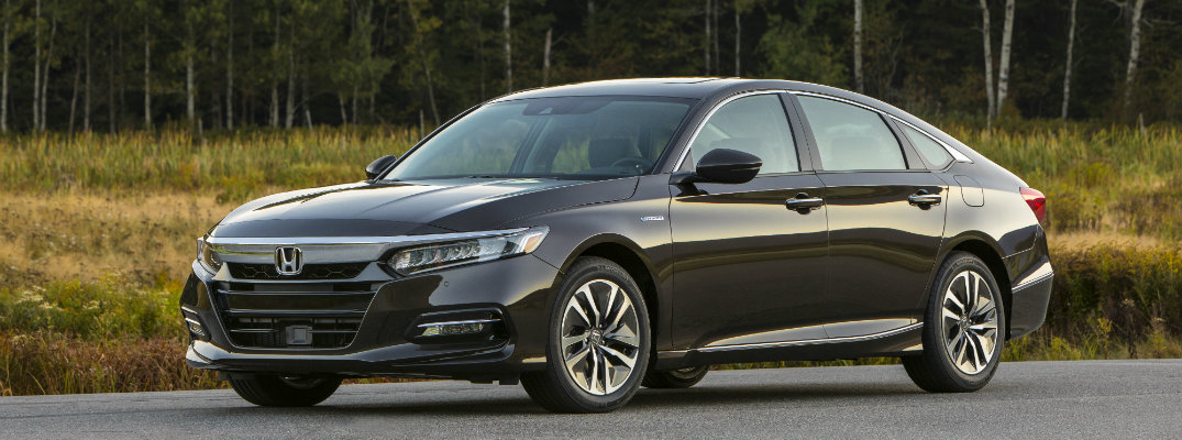 2018 Honda Accord Hybrid exterior front parked at a clearing with a grassy forest mountain background