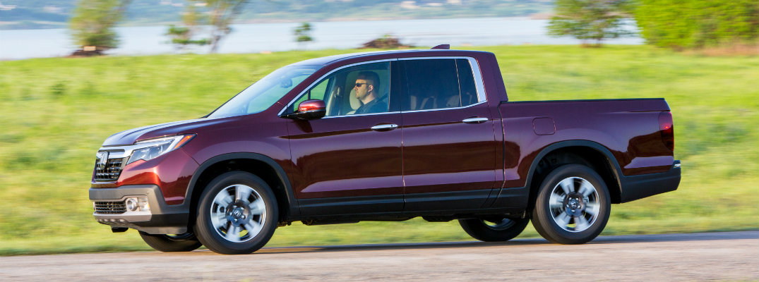 2019 Honda Ridgeline driving in open tropic green country
