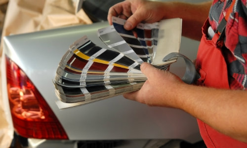 man browsing through carp paint options to choose his new car paint color