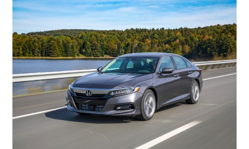 2018 Honda Accord exterior shot dark gray driving over a bridge above water and trees