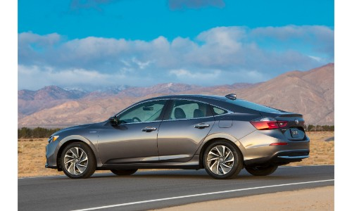 2019 Honda Insight exterior shot dark gray paint color side shot parked on a desert road with a blue sky background