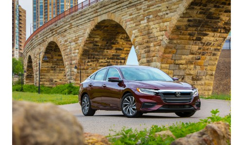 2019 Honda Insight exterior shot red parked under and arching brick bridge