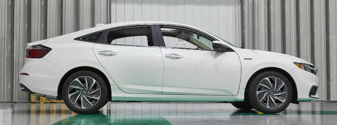 2019 Honda Insight exterior side shot white paint color parked in front of metal paneling