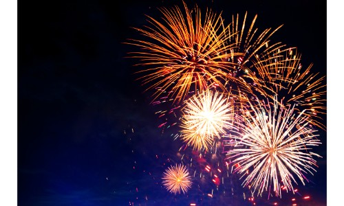 bright and colorful fireworks exploding in the night sky