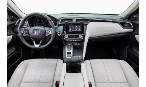 2019 Honda Insight exterior front seating white upholstery, dashboard infotainment, and steering wheel
