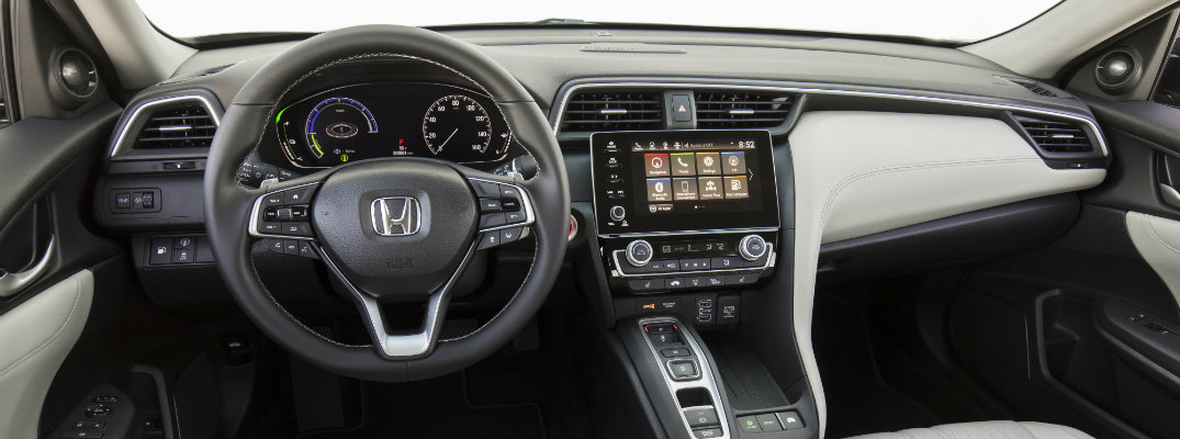 2019 Honda Insight interior shot of dashboard, infotainment system screens, and steering wheel with Honda logo badge