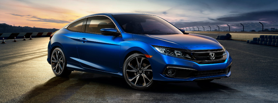 2019 Honda Civic Coupe Sport trim level exterior shot with blue paint job on an empty race track runway
