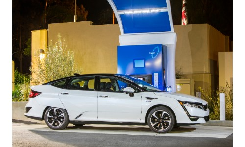 2018 Honda Clarity Fuel-Cell exterior side shot parked at a charging station at night