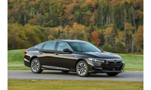 2019 Honda Accord Hybrid exterior side shot with dark gray paint color parked outside a farm field and forest