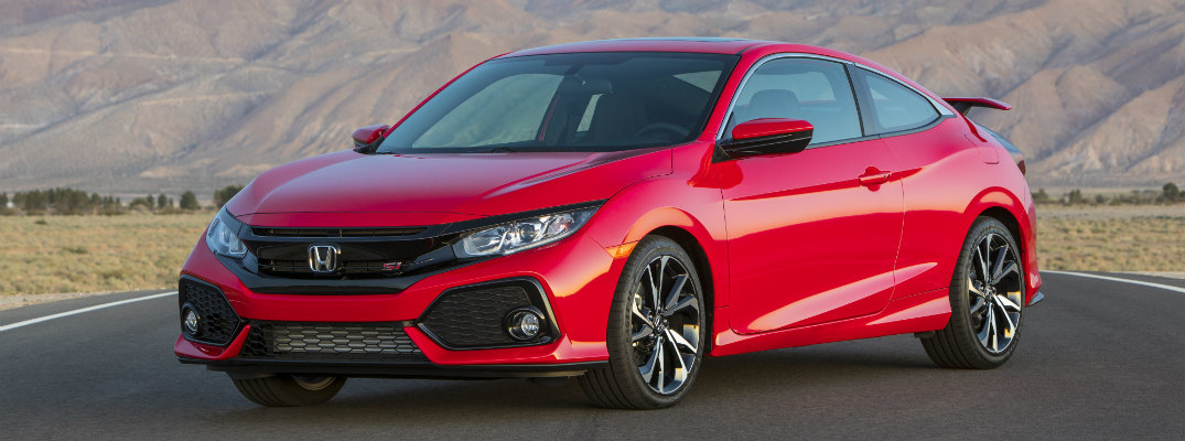2019 Honda Civic Si Coupe exterior shot with red paint color parked in a desert rows with mountains behind it