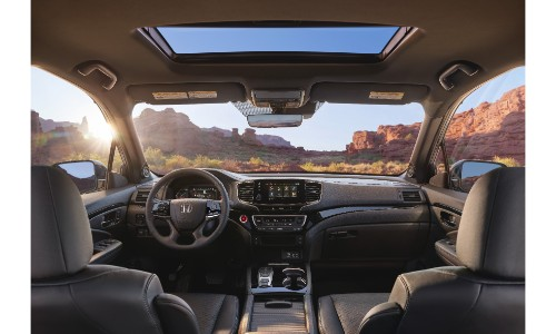 2019 Honda Passport interior shot of front seating, steering wheel, dashboard, and sunroof layout and design