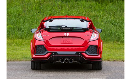 2019 Honda Civic Type R exterior rear shot of back bumper and triple exhaust with red paint color parked near a field of grass