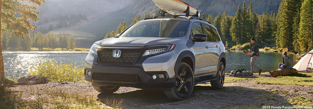 2019 Honda Passport Elite AWD with a canoe on top