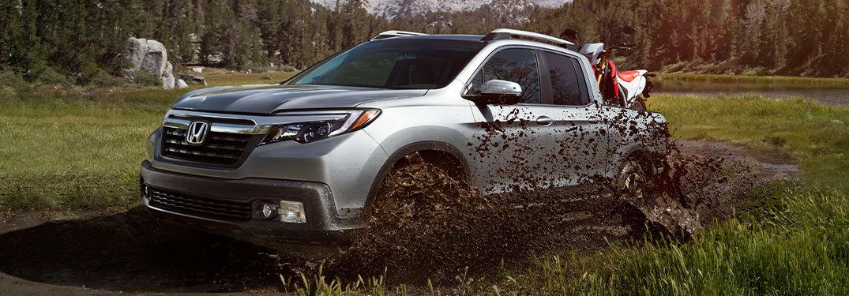 2020 Honda Ridgeline in gray driving through mud