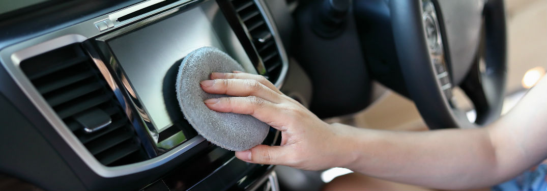 Woman cleaning dashboard