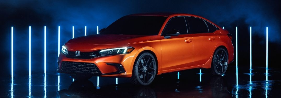 Orange 2022 Honda Civic Prototype on a Blue and Black Background