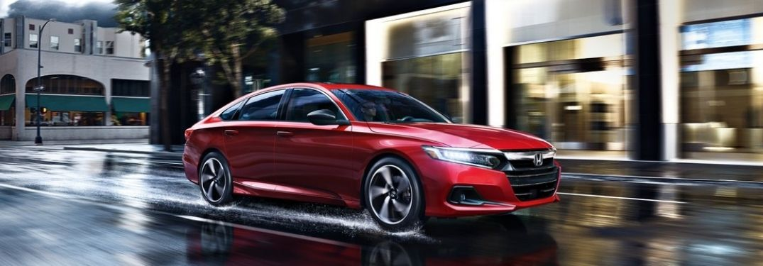 Red 2021 Honda Accord on Wet City Street