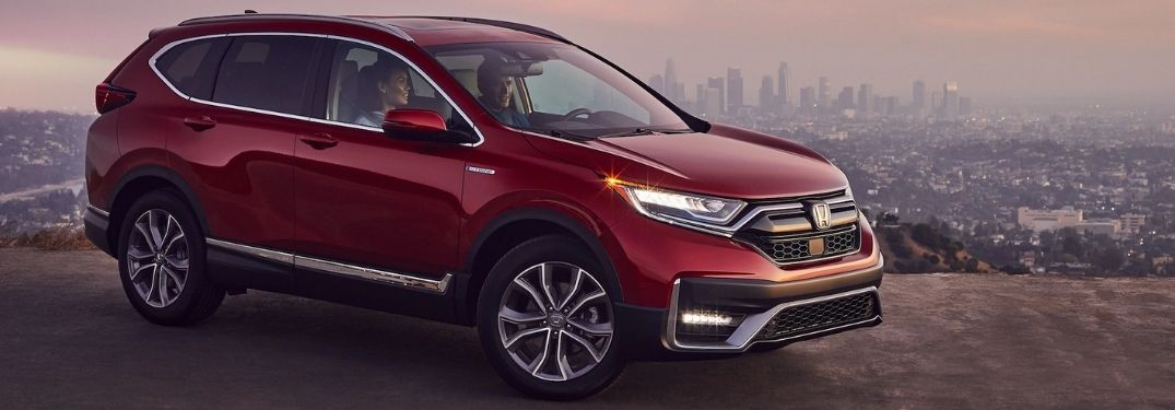 Red 2021 Honda CR-V on a Mountain Overlook with a City Skyline