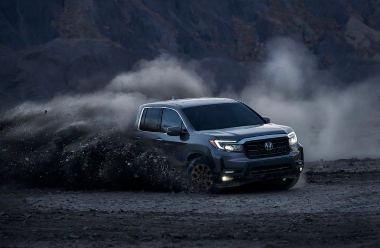 Gray 2021 Honda Ridgeline Kicking Up Mud