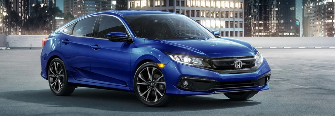 2021 Honda Civic Sedan with buildings in the background