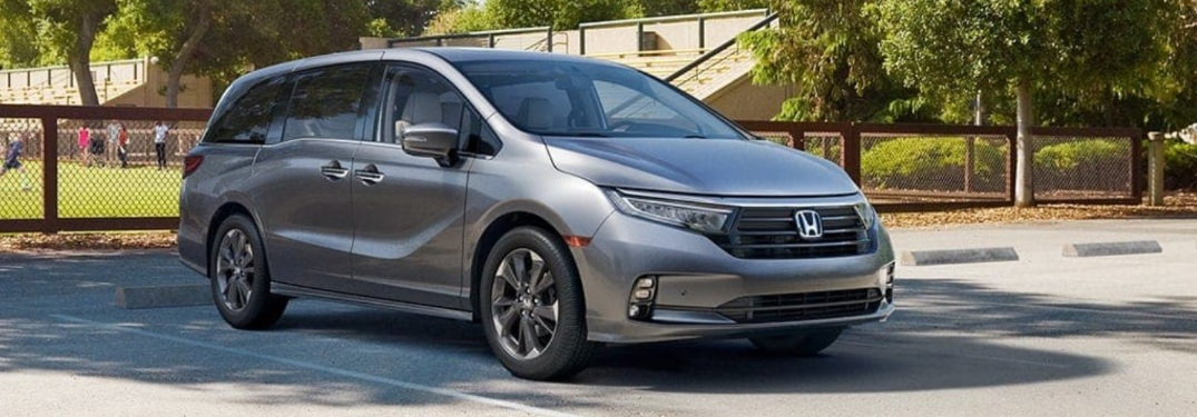2022 Honda Odyssey with a soccer game in the background