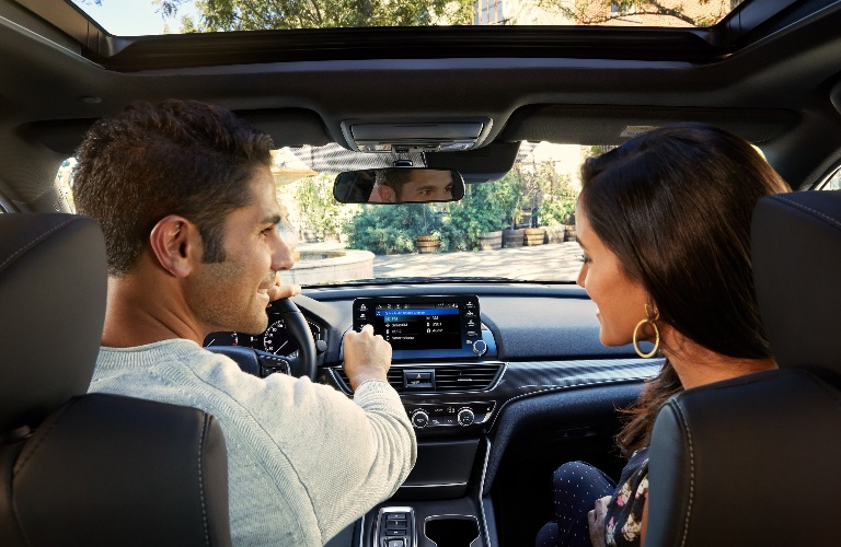 Two people inside of the 2021 Honda Accord