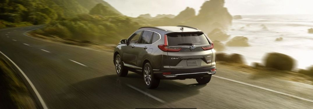 2021 Honda CR-V Hybrid Touring driving on a road by the sea