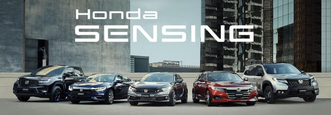 Image showing various Honda cars parked in front of buildings with Honda Sensing text written above