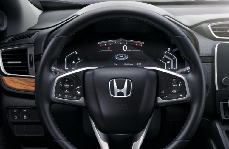 The steering wheel and dashboard of 2022 Honda CR-V Touring