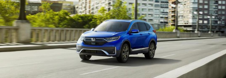 2022 Honda CR-V Touring driving on a road