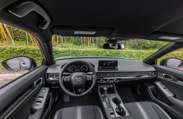Steering wheel and interior of the 2022 Honda Civic Sedan Sport