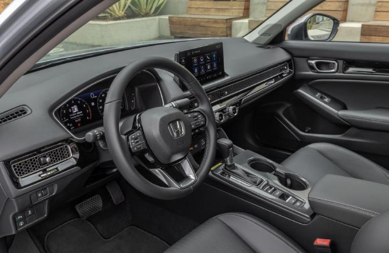 Steering wheel and interior of the 2022 Honda Civic Sedan Touring.