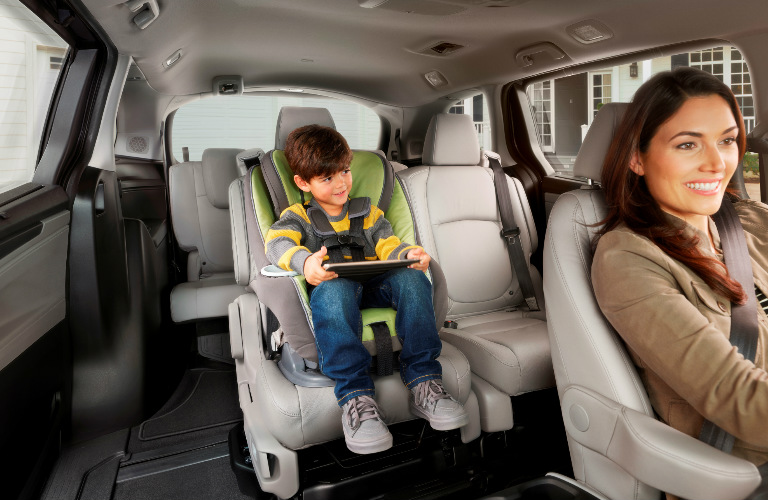 mom driving and son in second row seat of 2018 Honda Odyssey minivan