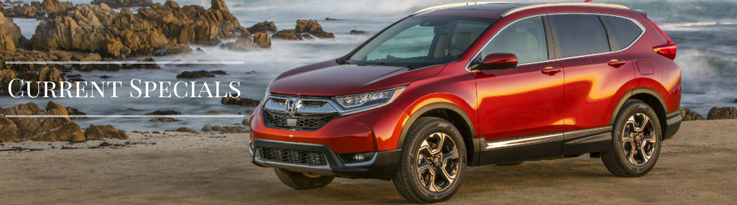 red 2017 Honda CR-V on a beach