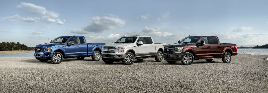 Three 2018 Ford F-150s in a lineup in various colors