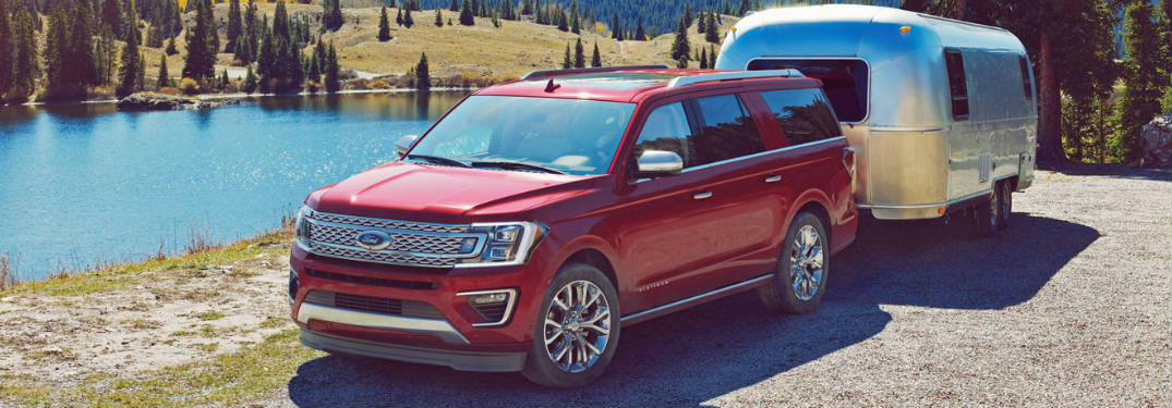2018 Ford Expedition red towing trailer