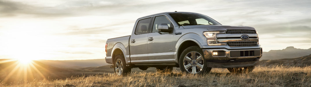 2018 Ford F-150 front silver with sunset behind