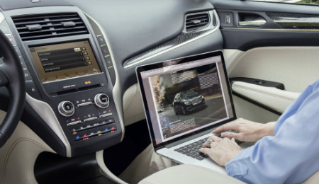 2019 Lincoln MKC interior with person using laptop
