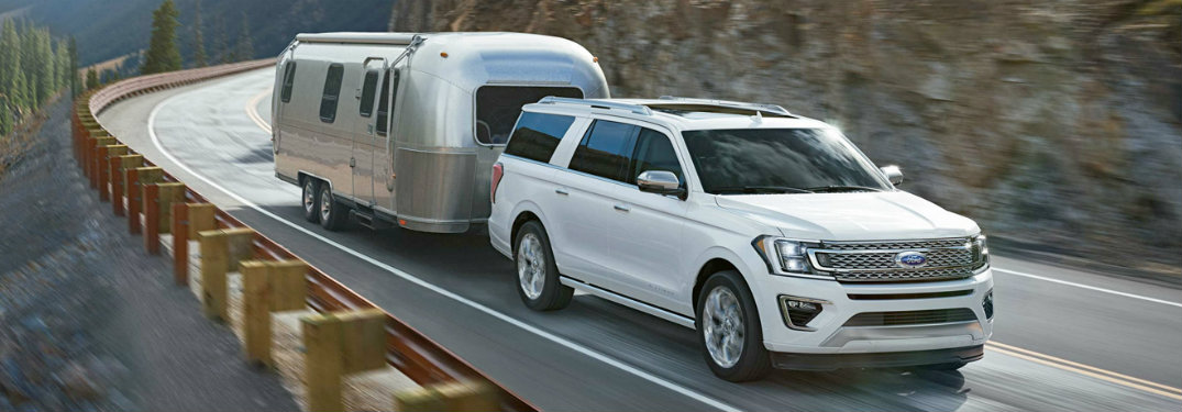 2018 Ford Expedition front view white towing trailer on road