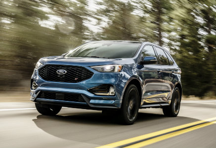 2019 Ford Edge ST blue front exterior of road