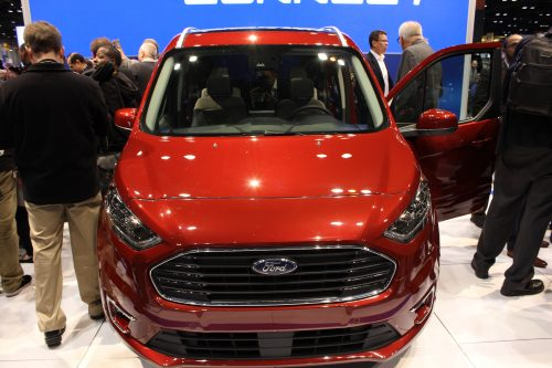 Head on view of the 2019 Ford Transit Connect Wagon at the Chicago Auto Show surrounded by people