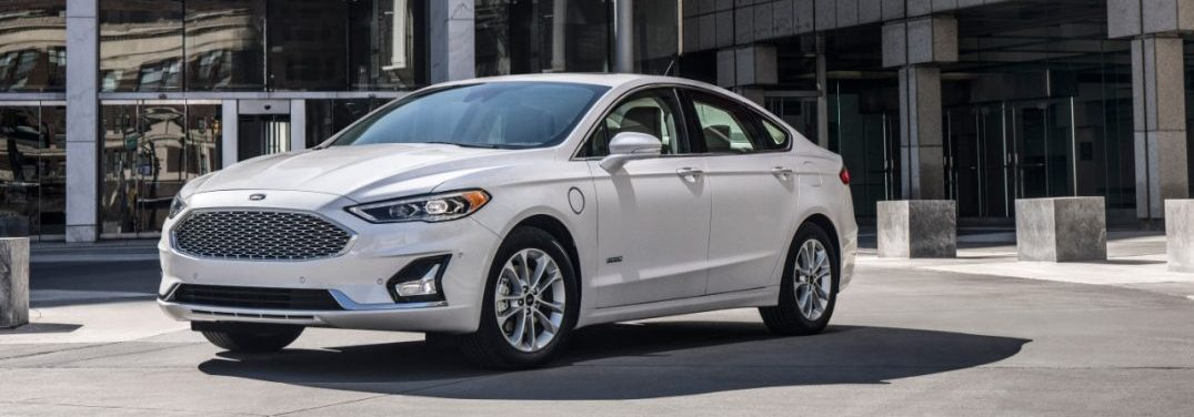 2019 Ford Fusion front quarter profile in front of a glass building