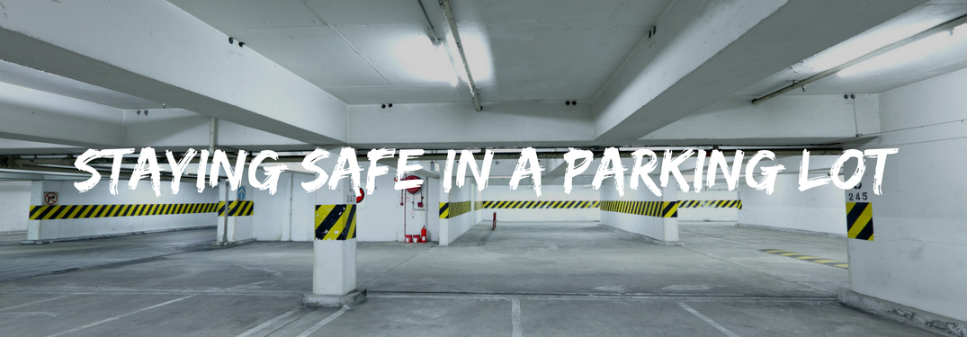 Image of a parking garage with text reading staying safe in a parking lot over top