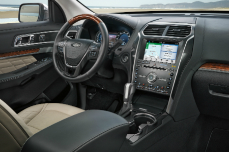 Front Interior Of  Ford Explorer Including Steering Wheel And Infotainment System
